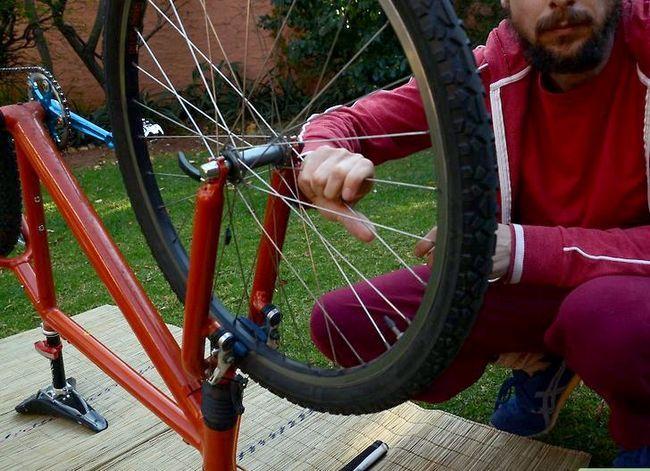 छवि शीर्षक वाला एक बच्चा साइकिल रिम चरण 3