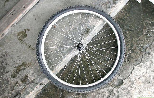 एक पॅट रैक के चरण 1 के रूप में एक साइकिल टायर फ़्रेम का उपयोग करें